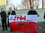 transparent trzymany przez ks.Jarosława Wąsowicza i Andrzeja Duffek